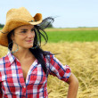 Pretty cowgirl smiling — Stock Photo #39645573