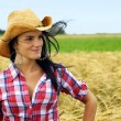 Pretty cowgirl smiling — Stock Photo