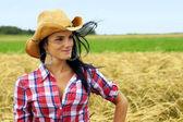 Pretty cowgirl smiling — Stock Photo