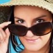 Woman looking over sunglasses — Stock Photo