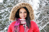 Young woman with red winter coat — Stock Photo