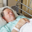 Senior man in hospital bed — Stock Photo