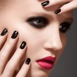 Beautiful close-up portrait of fashion woman model with glamour bright makeup, dark magenta lipstick, black nail polish. Evening catwalk style, trend visage and manicure — Stock Photo #12252228