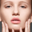 Make-up & cosmetics, manicure. Closeup portrait of beautiful woman model face with clean skin, full glossy lips. Natural skincare beauty, clean soft skin, french manicure — Stock Photo #12252230