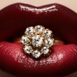 Close-up of beautiful woman's lips with bright fashion dark red glossy makeup. Macro lipgloss cherry make-up. Mouth with wedding gold diamond ring — Stockfoto
