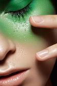 Beauty close-up portrait of beautiful woman model face with wonderful fashion freshness green make-up — Stockfoto