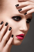Beautiful close-up portrait of fashion woman model with glamour bright makeup, dark magenta lipstick, black nail polish. Evening catwalk style, trend visage and manicure — Stock Photo