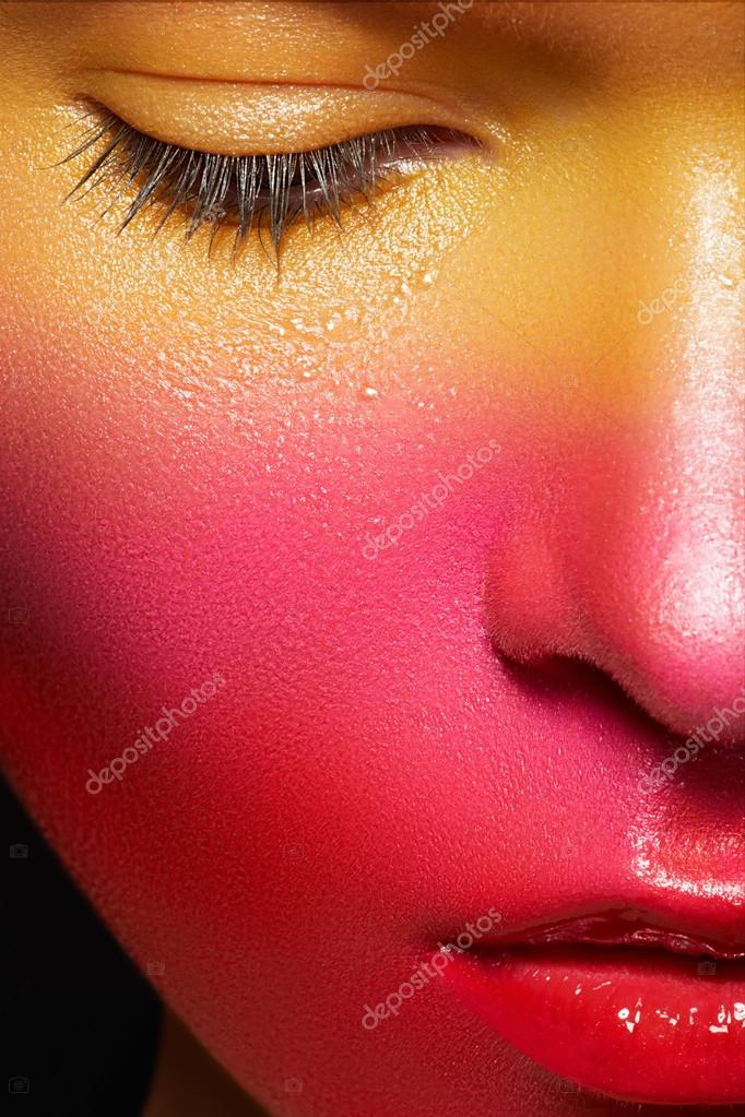 Beauty close-up portrait of beautiful woman model face with magic creative fashion multicolored make-up. Face painting, cosmetics, beauty and make-up.  — Stock Photo #12252225