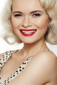 Fashion portrait of beautiful laughing woman model with red lips make-up and long curly blond hair on white background. Pin-up retro style. Healthy happy smile with white teeth — Stock fotografie