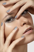Spa, beauty, skincare, wellness & health. Glamour close-up portrait of beautiful woman model face with purity healthy skin & silver make-up and grey manicure. Cold winter christmas makeup — Stock Photo