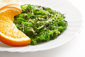 Japanese cuisine , seaweed salad in white plate. Healthy organic sea food — Stock Photo