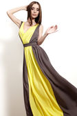 Beautiful luxury woman in fashion long dress with slim waist. Glamour make-up, sexual pose, long straight hair — Stock Photo