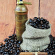 Coffee beans in burlap bag, vintage grinder and cinnamon sticks — Stok fotoğraf