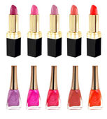 Lipstick and nailpolish in different colors — Stock Photo