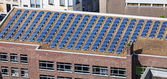 Solar panels on building roof — Stock Photo