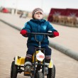 Stock Photo: Boy on tricycle