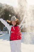 Teenager girl playing with snow in park — Stock Photo