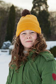 Teenager girl in a snowy park — Stock Photo