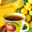Royalty-Free Stock Photo: Tea cups and yellow tulips