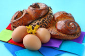 Buns with poppy seeds and brown eggs — Stock Photo