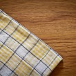 Tablecloth on wooden table background — Foto Stock