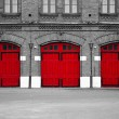 Fire Station with red doors - Stock Photo
