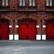 Foto Stock: Fire Station with red doors