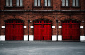 Fire Station with red doors — Stock Photo