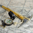 Stock Photo: The ice - axe and compass