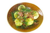 Boiled potato with fried bacon  — Stock Photo