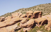 Red Boulders on Desert Hillside — Stock Photo