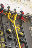 Yellow Pipes on Black Barge — Stock Photo