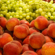 Stock Photo: Peaches and Grapes in Market