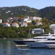 Stock Photo: Two Yachts Beneath Tropical Homes