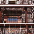 Stock Photo: Fire Escape Ascending Red Brick