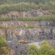 Stock Photo: Yellow Front End Loader on Stripped Hillside