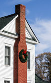 Chimney with Christmas Wreath on White House — Stock Photo