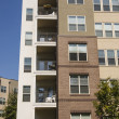 Balconies and Windows in Condo Building - Stock Photo