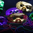 Mardi Gras Masks and Beads on Black — Stock Photo