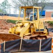 Stock Photo: Yellow Bulldozer on Dirt Site