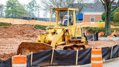 Yellow Bulldozer on Dirt Site — Stock Photo