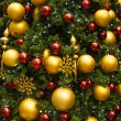Gold and Red Christmas Ornaments on Green Tree — Stock Photo