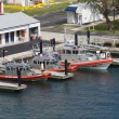 Coast Guard Boats Tied to Docks - Stock Photo