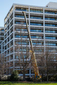 Crane Working on White Terraced Office Building — Stock fotografie