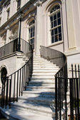 White Marble Steps Between Black Iron Banister — Stock Photo