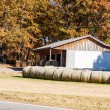 Stock Photo: Rolled Sod by Old Rusty Barn