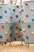 Kids Climbing Wall with Colorful Handholds — Stock Photo