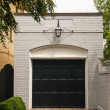 Stock Photo: White Brick Garage with Black Door