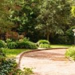 Brick Driveway Past Landscaped Garden — Stock Photo
