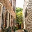 Stock Photo: Brick Walkway Between Brick and Siding Homes